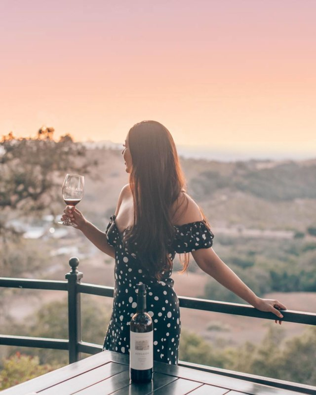We had such an awesome weekend exploring Paso Robles! If you haven't been to this hidden gem, time to add it to your travel list. Our private tasting up at this scenic viewpoint at @adelaidavineyards was nothing short of spectacular. ⠀⠀ For the price of a regular tasting in Napa, you can book this private tasting ($45/person) and you guys, it's epic. I'm still dreaming of their zin and this sunset. Swipe to see more! 🌄 ⠀⠀ Dress is @loversfriendsla from @revolve. 🖤 #revolveme #wtfabtravel #pasorobles